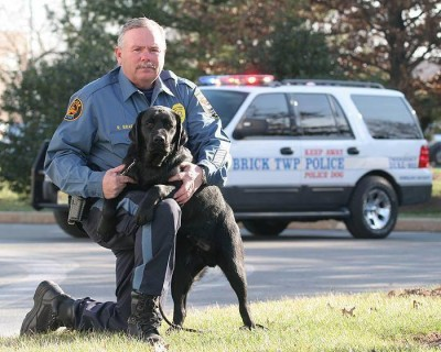 Brick police officer Ron Braen and Eros, a K9 who died Friday. (Photo: NJSPCA)