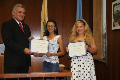 From left to right: Freeholder Director Joseph H. Vicari, who serves as liaison to the county vo-tech schools, and scholarship winners Arely Aguirre, Brick Township, and Amanda Menth, Toms River
