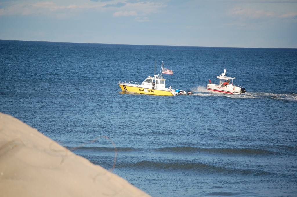 The Laurelton Fire Company boat, as well as a Sea Tow boat, in the ocean off Brick Beach 1 following a rescue Sunday. (Photo: Daniel Nee)