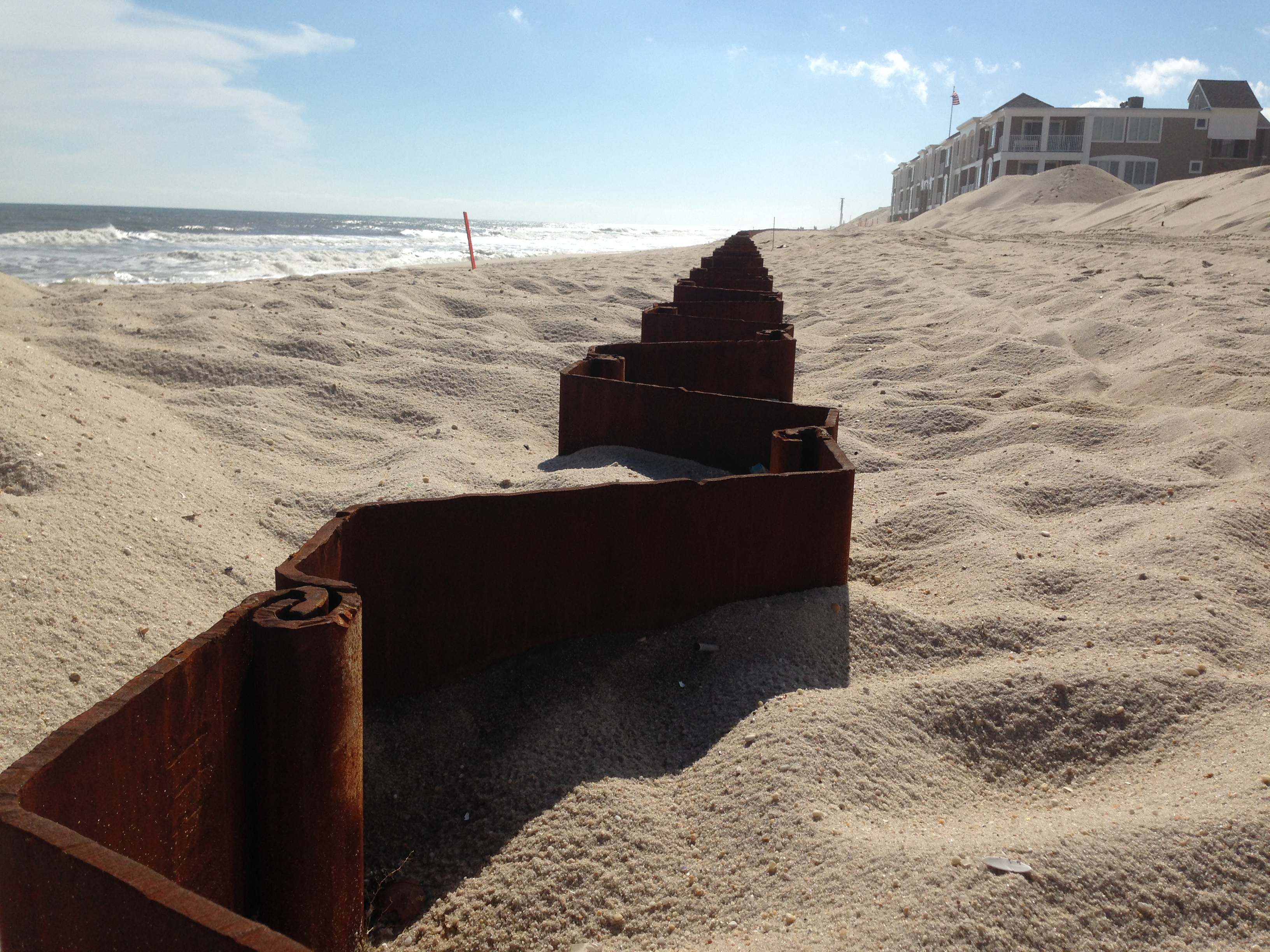 Sheetpile installed at Brick Beach III. The sheet pile will eventually be capped and buried in sand dunes. (Photo: Daniel Nee)