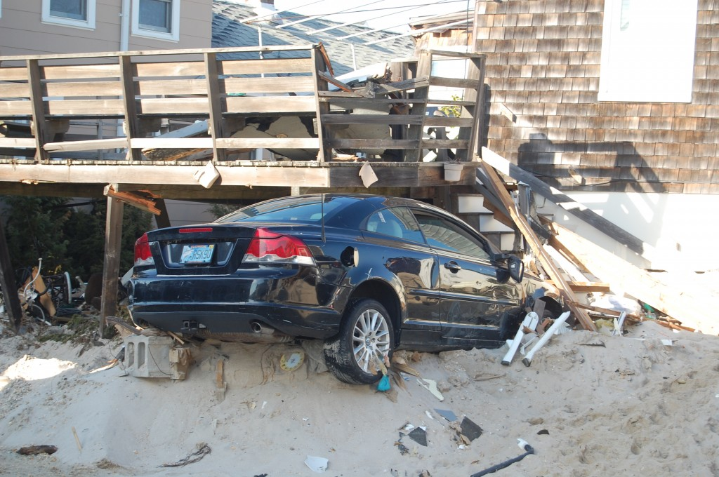 A car that stuck inside a house in Brick's Normandy Beach section, Nov. 2012. (Photo: Daniel Nee)