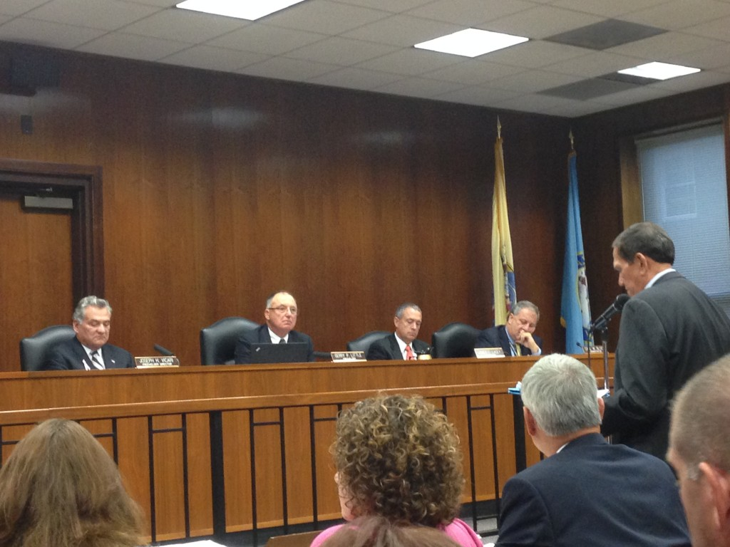 William Santos (right, at microphone) addresses the Ocean County freeholders on Oct. 15, 2014. (Photo: Daniel Nee)