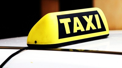 A taxicab sign. (Photo:  Leonid Mamchenkov/Flickr)