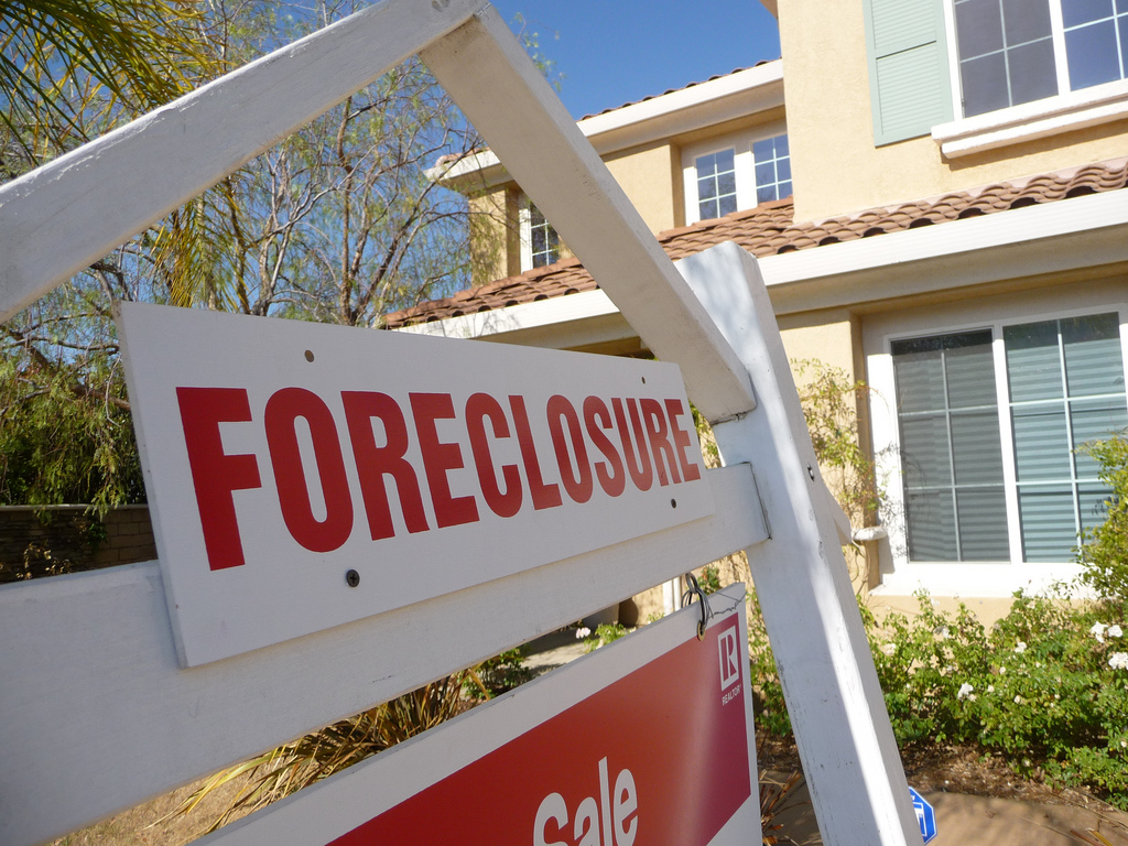 A foreclosure sign in front of a home. (Credit: Jeff Turner/Flickr)
