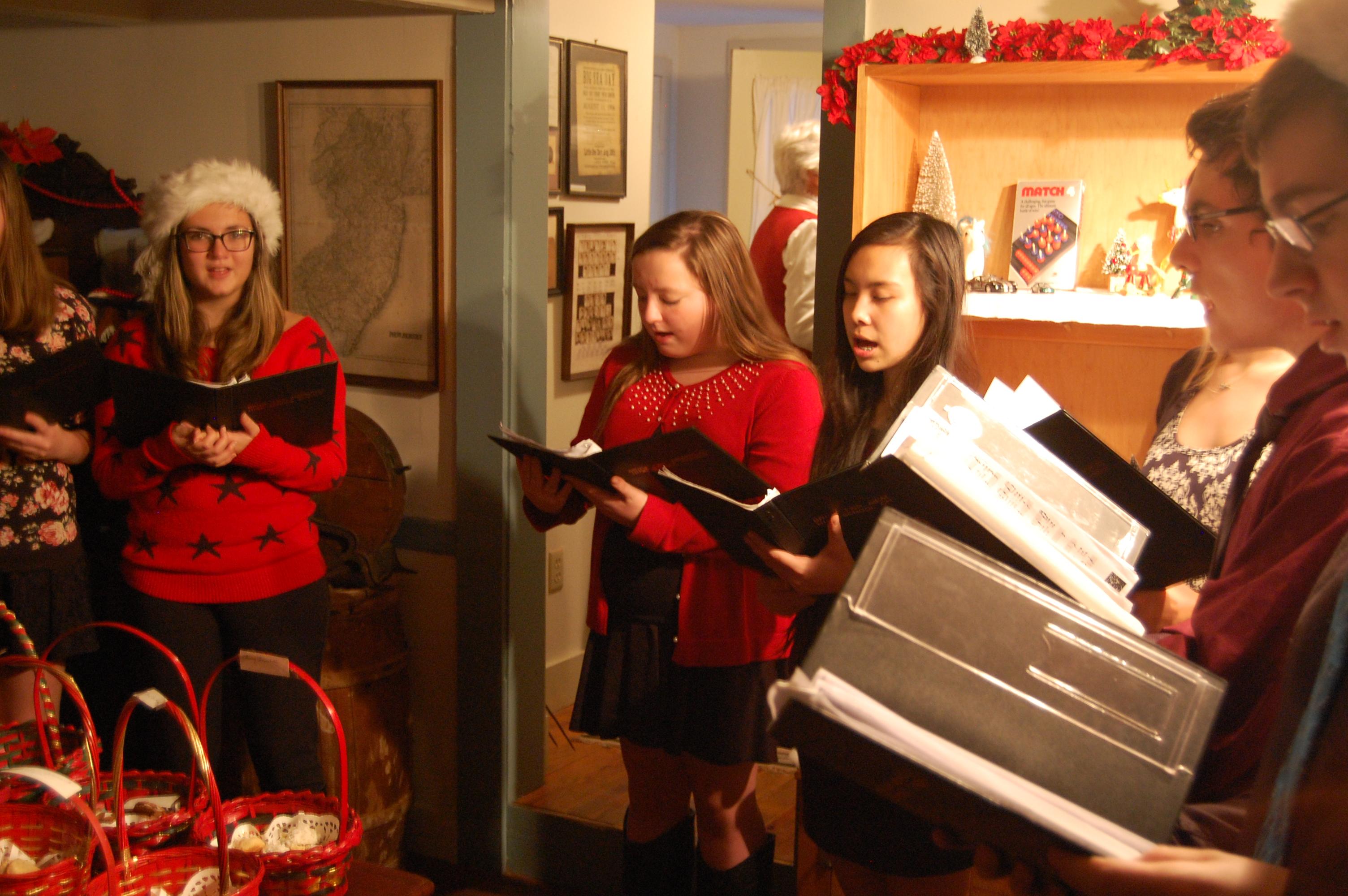 Members of the Brick Memorial High School chorus sing Christmas carols at the Havens Homestead Museum, Dec. 5, 2014. (Photo: Daniel Nee)
