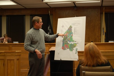 Township Planner Mike Fowlers shows off a display of the new color zoning maps. (Photo: Daniel Nee)