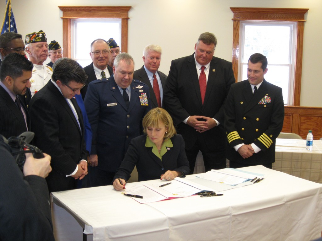 Lt. Gov. Kim Guadagno signs a bill into law in Brick, N.J. renaming the Route 35 bridge over the Manasquan River for veterans. (File Photo)