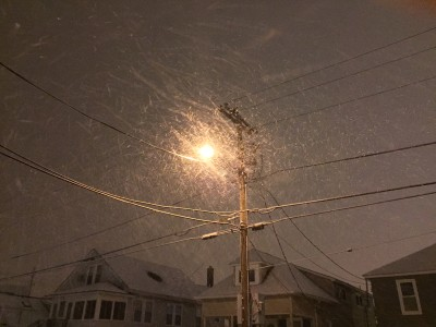 Snowflakes blowing Saturday night under a street lamp. (Photo: Daniel Nee)