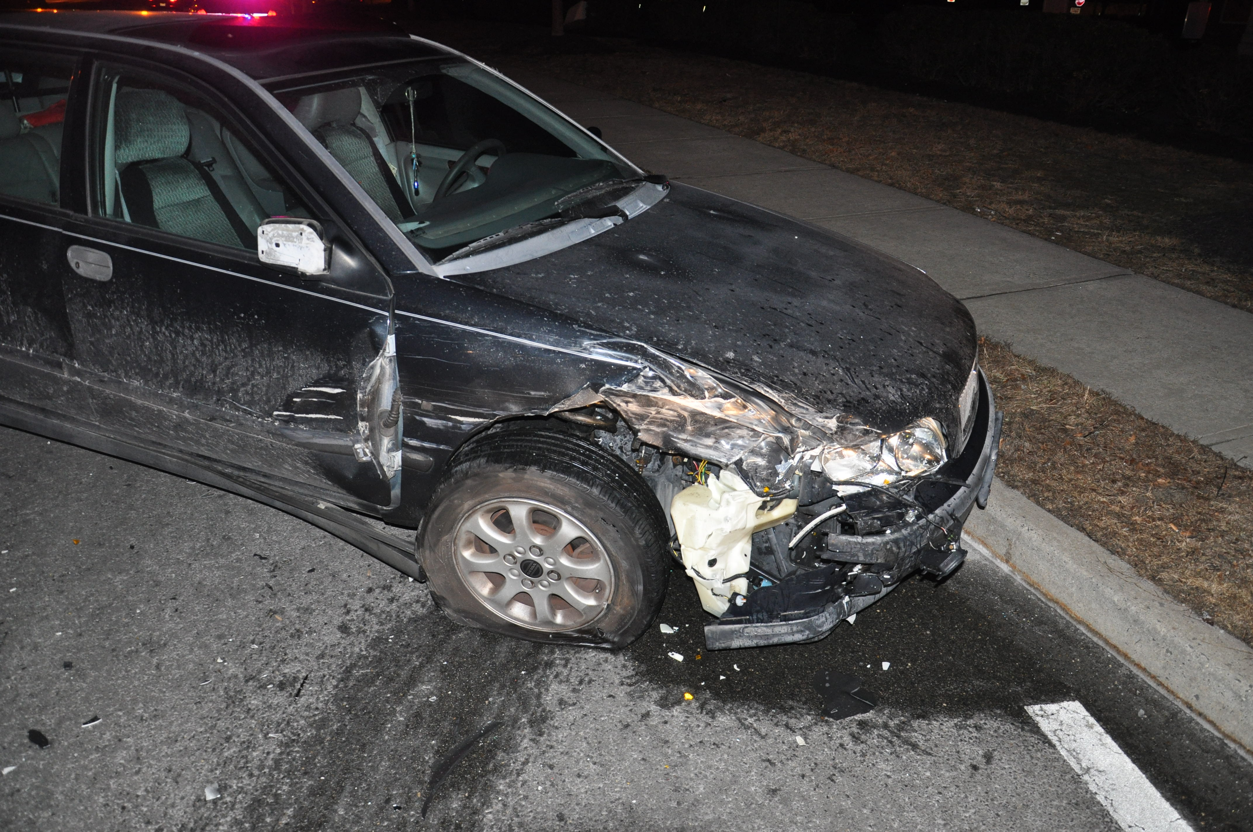 Damage resulting from a crash that occurred when a driver rear-ended a Toms River police car, Feb. 11, 2015. (Photo: TRPD)