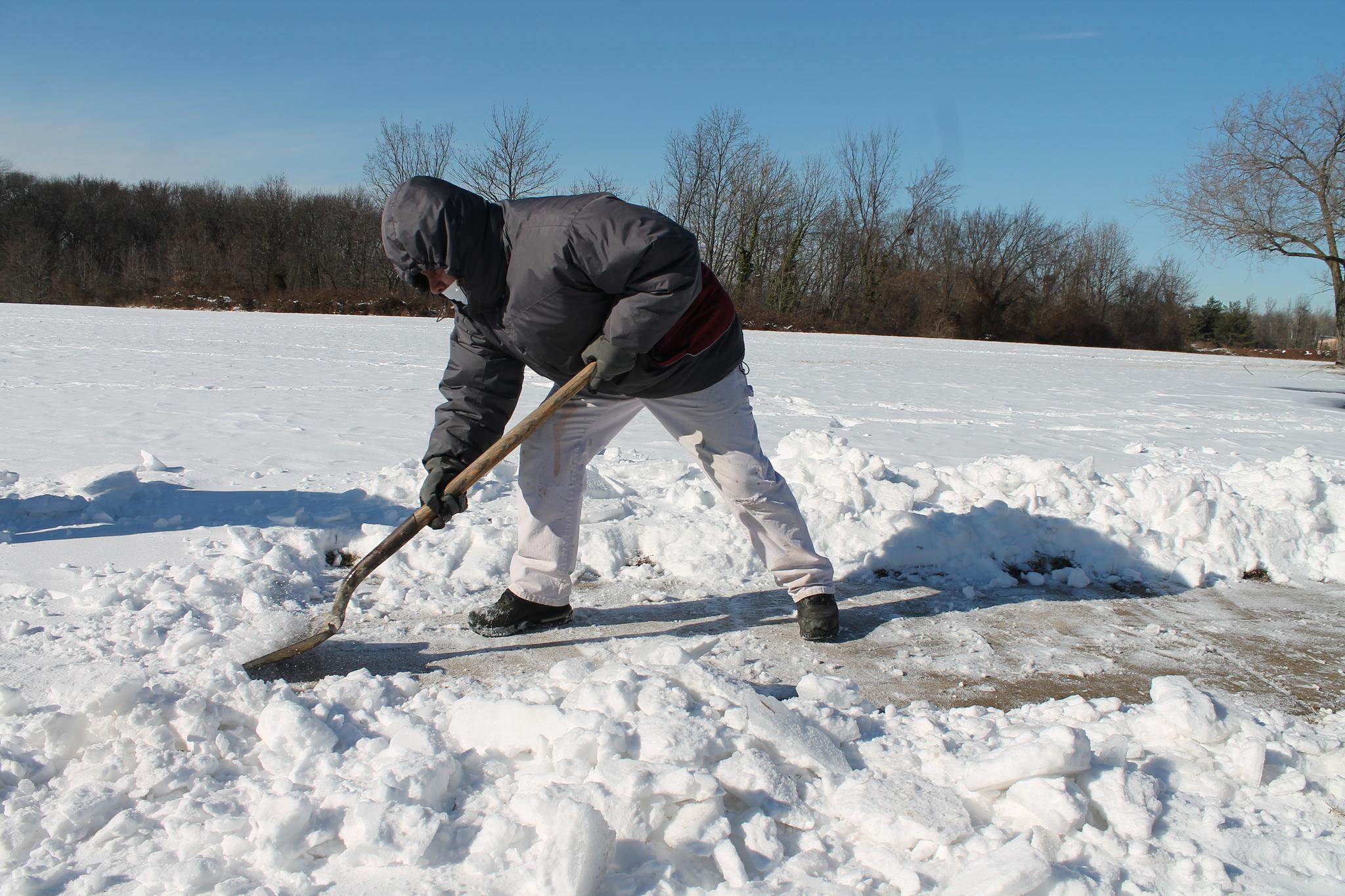 Shoveling snow. (Credit: Elvert Barnes/Flickr/File Photo)