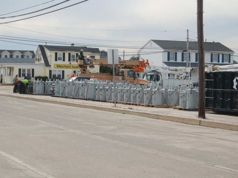 In the weeks following Superstorm Sandy, the parking lot of a Normandy Beach church began to be used as a construction staging area. (Photo: Daniel Nee, Nov. 2012)