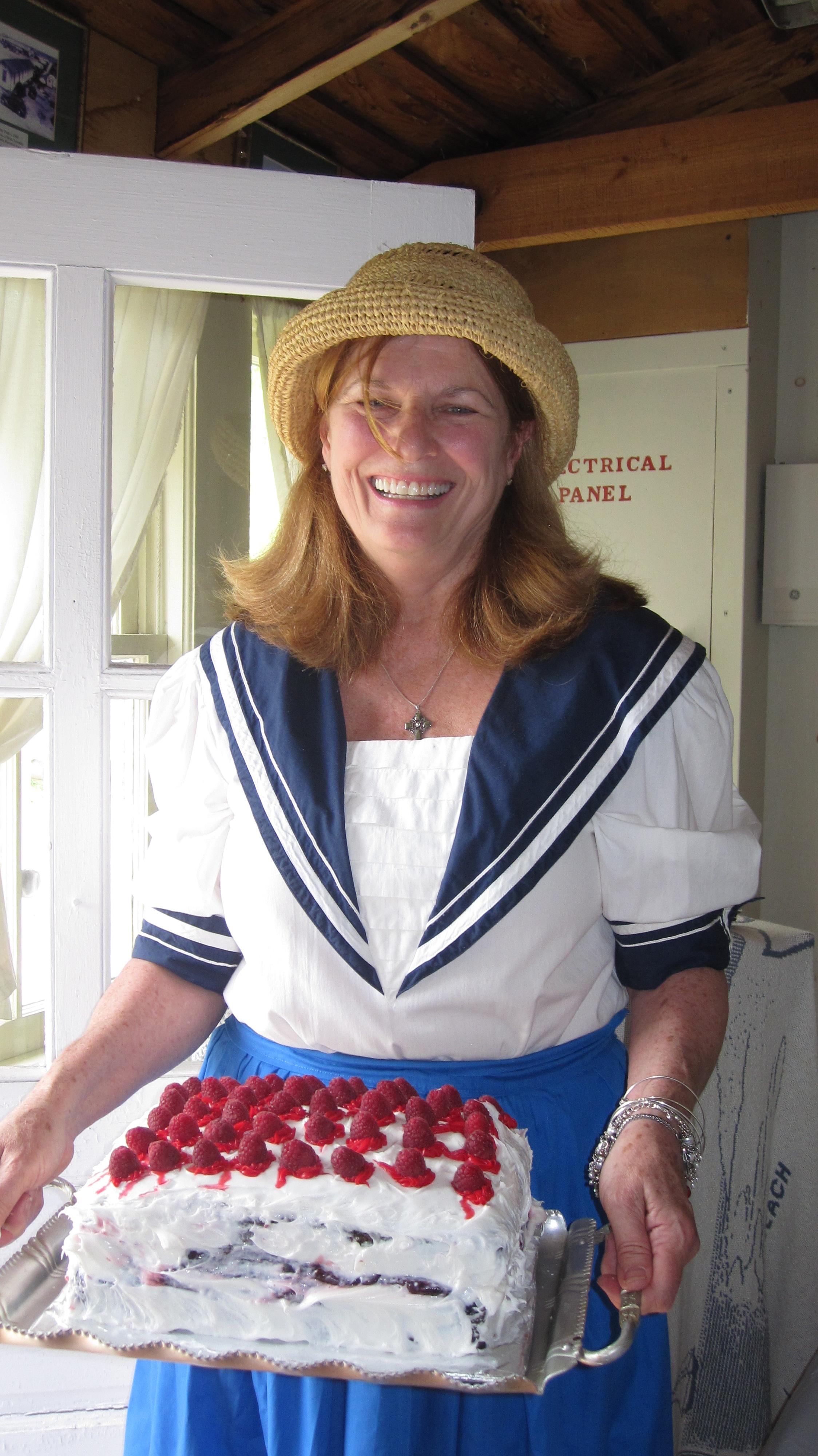 Recording secretary Elaine McGuire of Brick with cake for the tea.