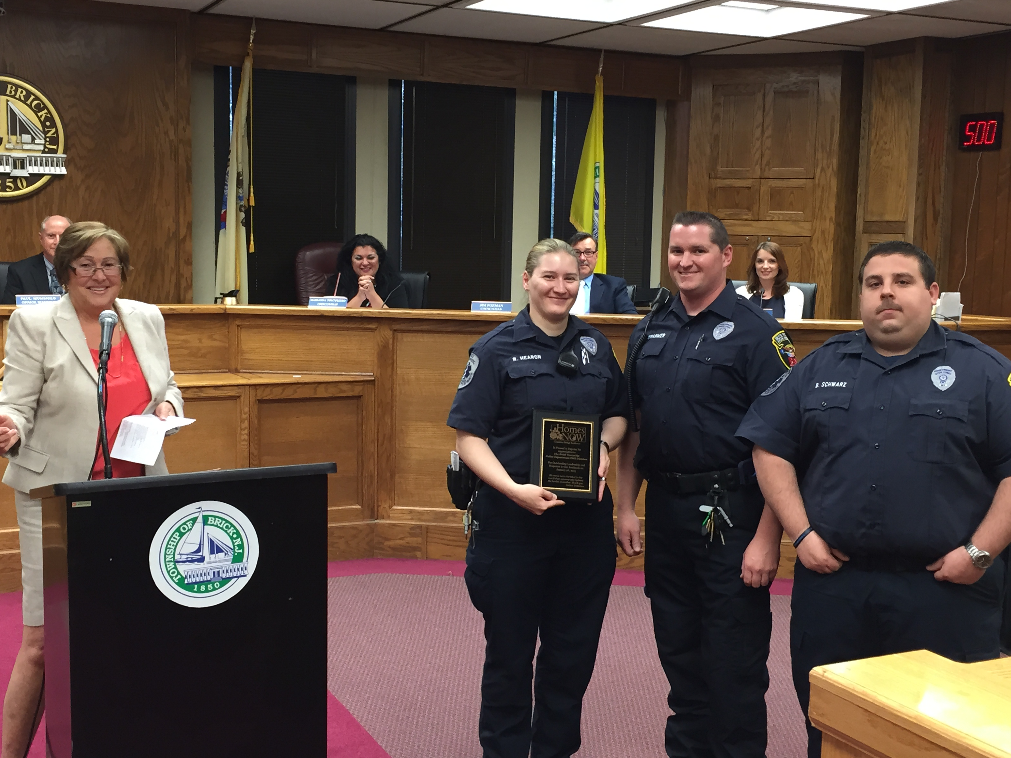Brick Police EMTs recognized by Carol Wolfe for their efforts in a Jan. 2015 apartment fire. (Photo: Daniel Nee)