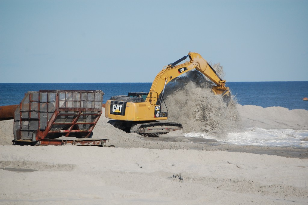 Crews work on a beach and dune replenishment project in Long Beach Township, Oct. 15, 2015. (Photo: Daniel Nee)