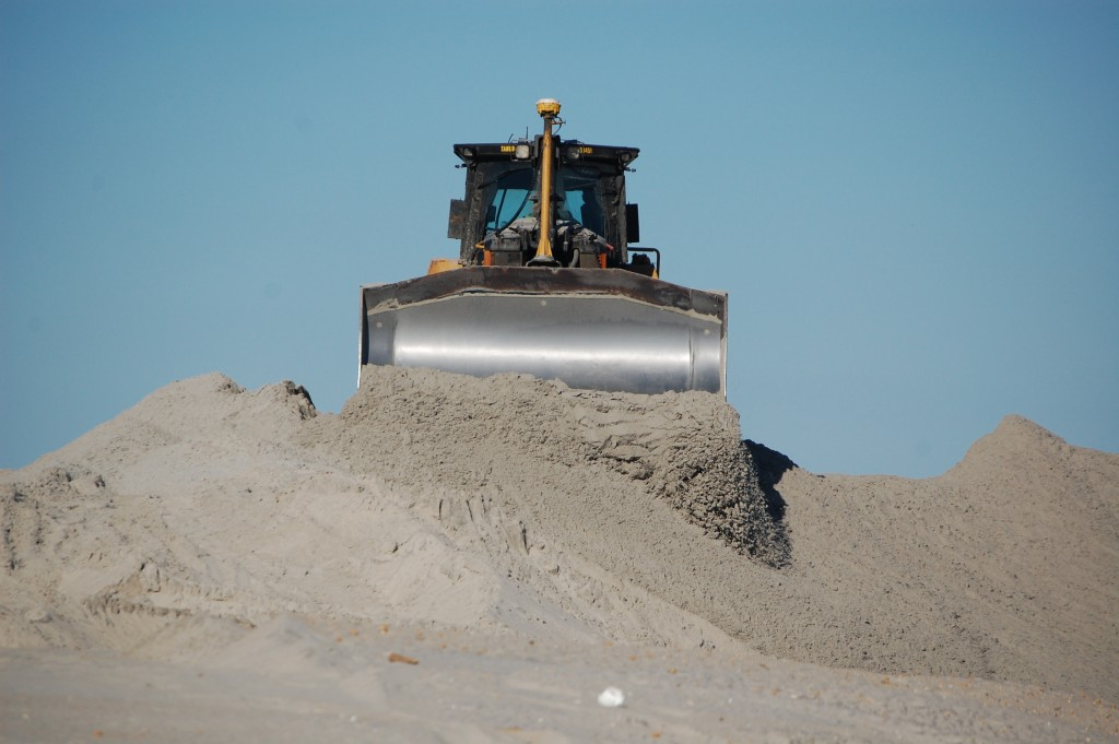 Crews move sand in a beach and dune replenishment project in Long Beach Township, Oct. 15, 2015. (Photo: Daniel Nee)