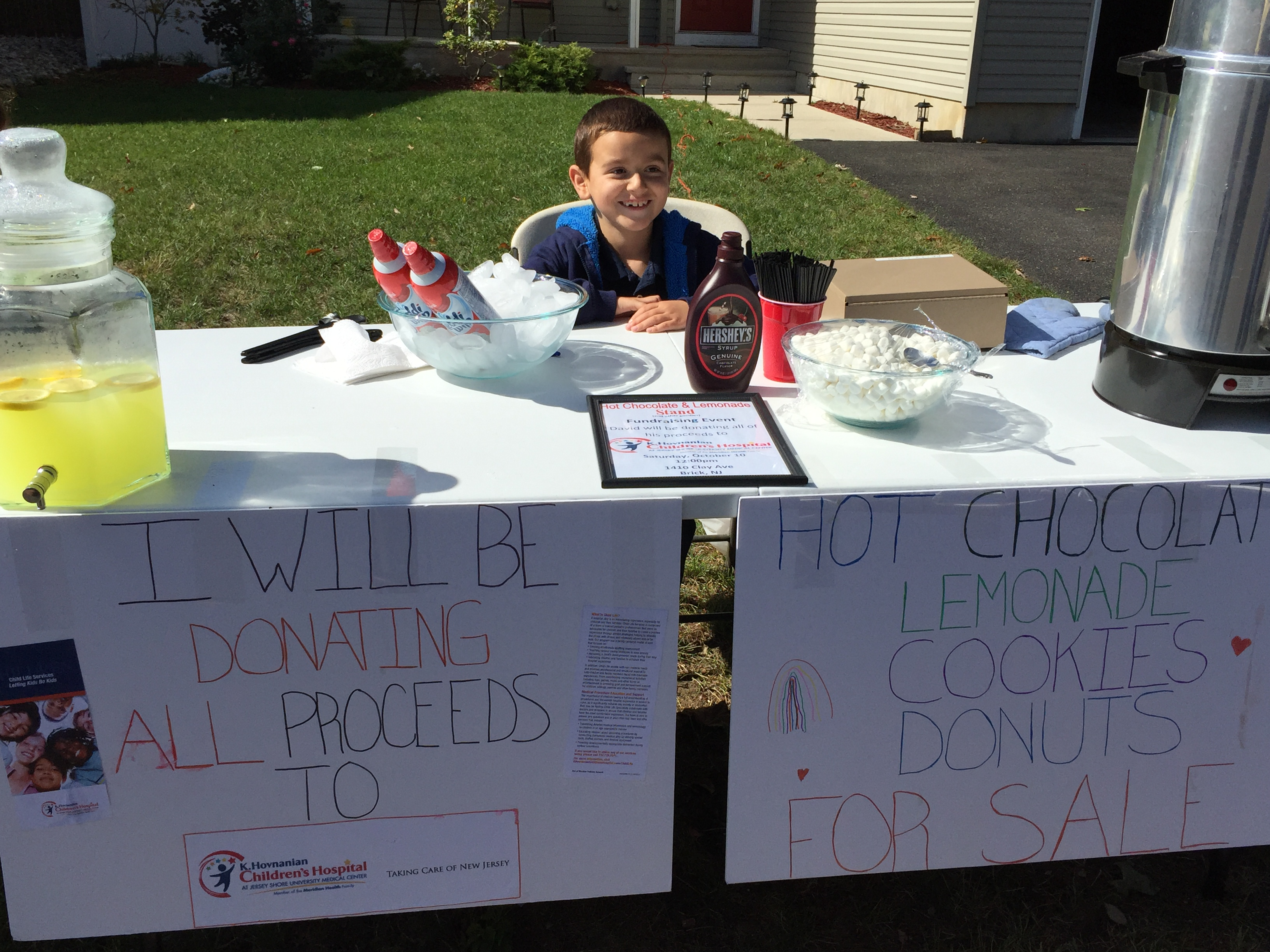 David Torres, 7, runs a charity lemonade stand in front of his house. (Photo: Kristina Torres)
