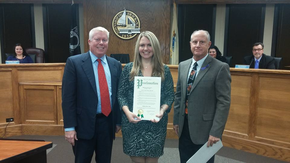 Brittany Bucco (center) with Mayor John Ducey (left) and Council President Paul Mummolo. (Photo: Brick Twp.)