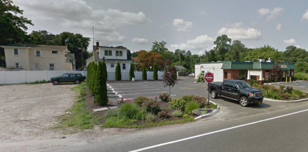 Denino's (right) and an adjacent, non-paved lot that will be used for a parking expansion. (Credit: Google Maps)