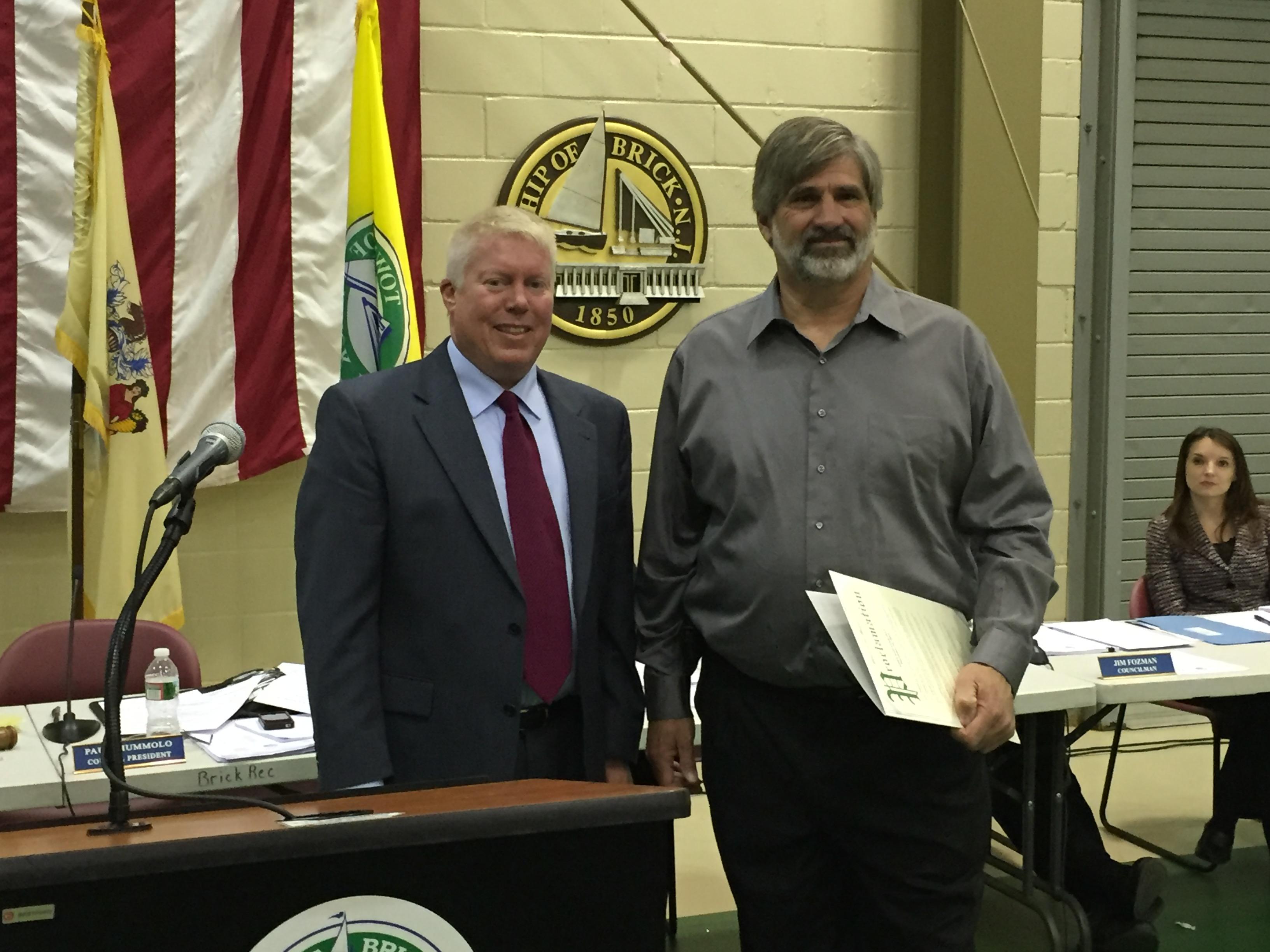 John Koester receives recognition from Mayor John Ducey. (Photo: Daniel Nee)
