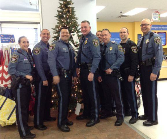 Brick police officers help kids pick out toys at the local Walmart store. (Photo: Brick Twp. Police)