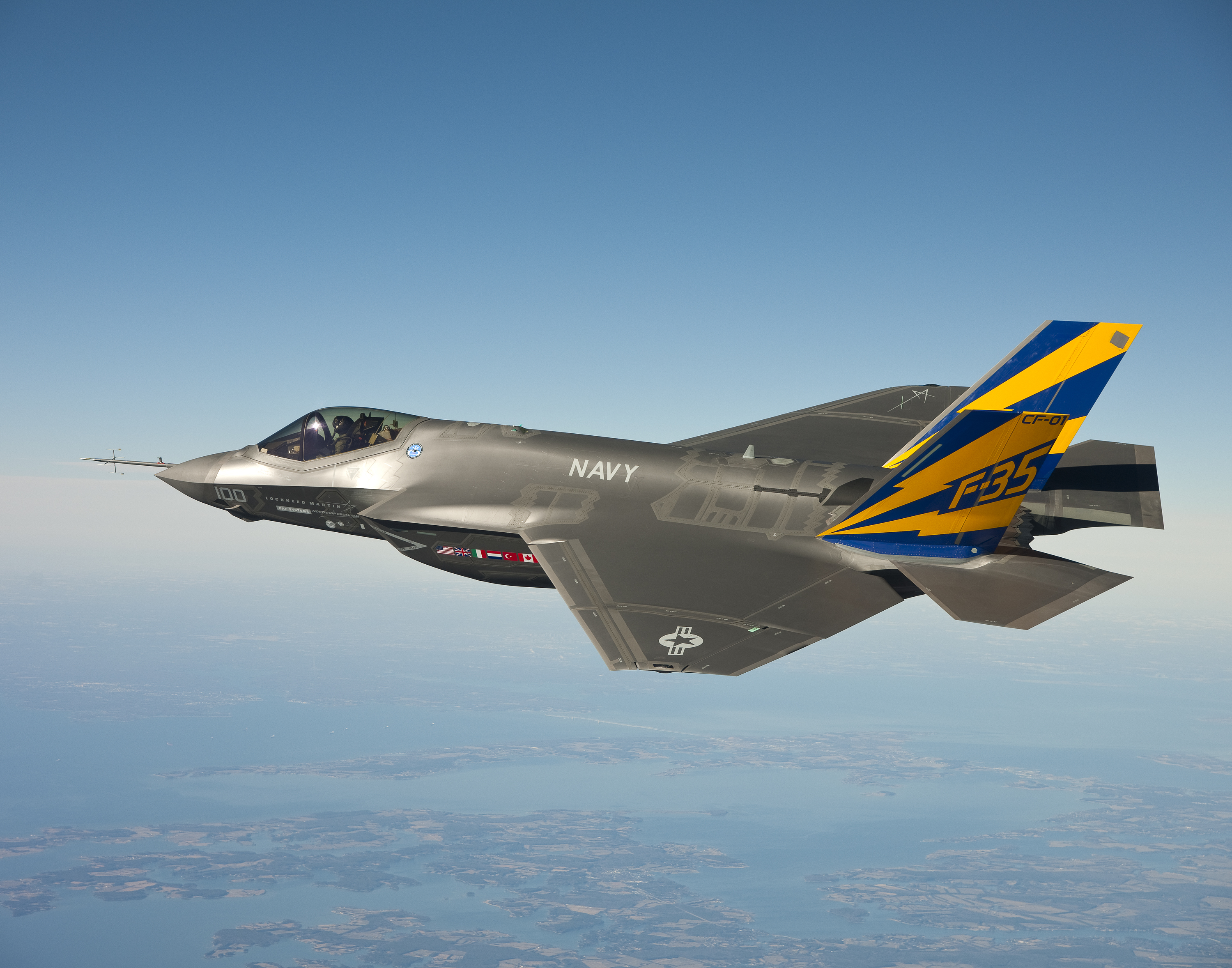 The U.S. Navy variant of the F-35 Joint Strike Fighter, the F-35C, conducts a test flight over the Chesapeake Bay. (U.S. Navy photo courtesy Lockheed Martin/Released)