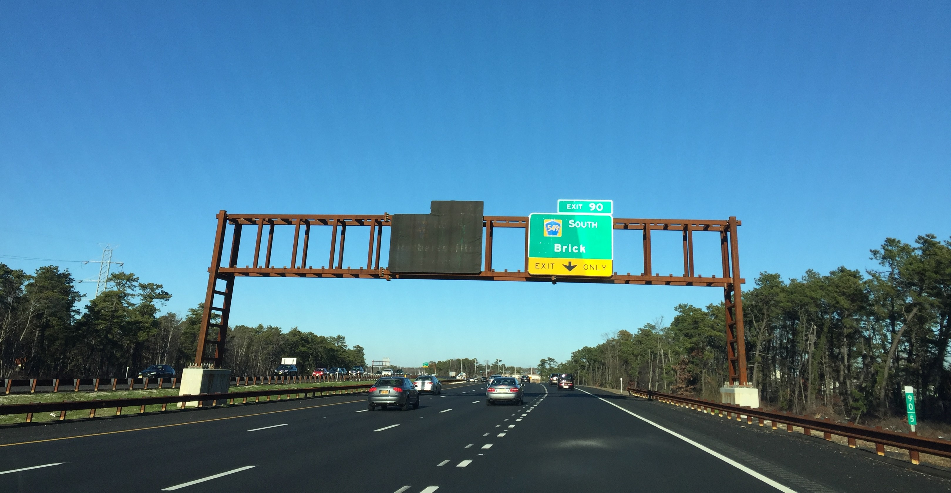 """Signage for the future """"Herbertsville"""" exit on the Garden State Parkway, covered up. (Photo: Daniel Nee)"""