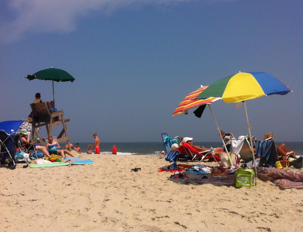 Beachgoers relax during a sunny summer day. (Photo: Daniel Nee)
