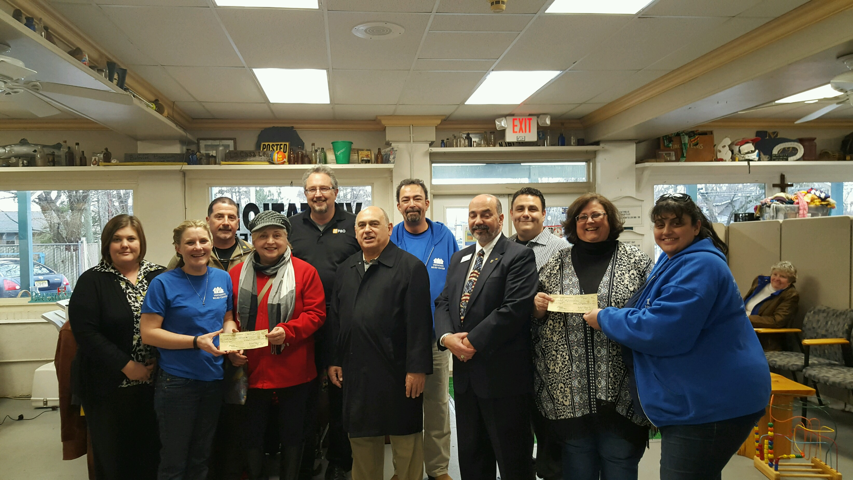 Members of the Brick Township Rotary Club present members of the Visitation Relief Center with a donation. (Photo: Brick Rotary)