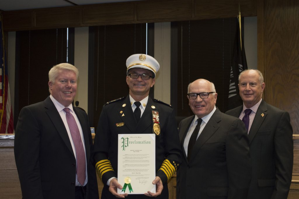 Kevin Batzel is honored by Mayor John Ducey and township council members. (Photo: Daniel Nee)