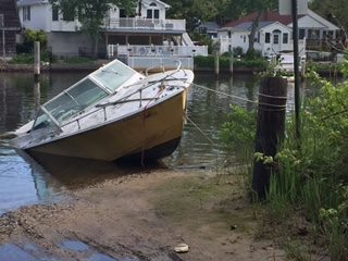 A boat set adrift in the Metedeconk River. (Photo: Brick Twp. Police)