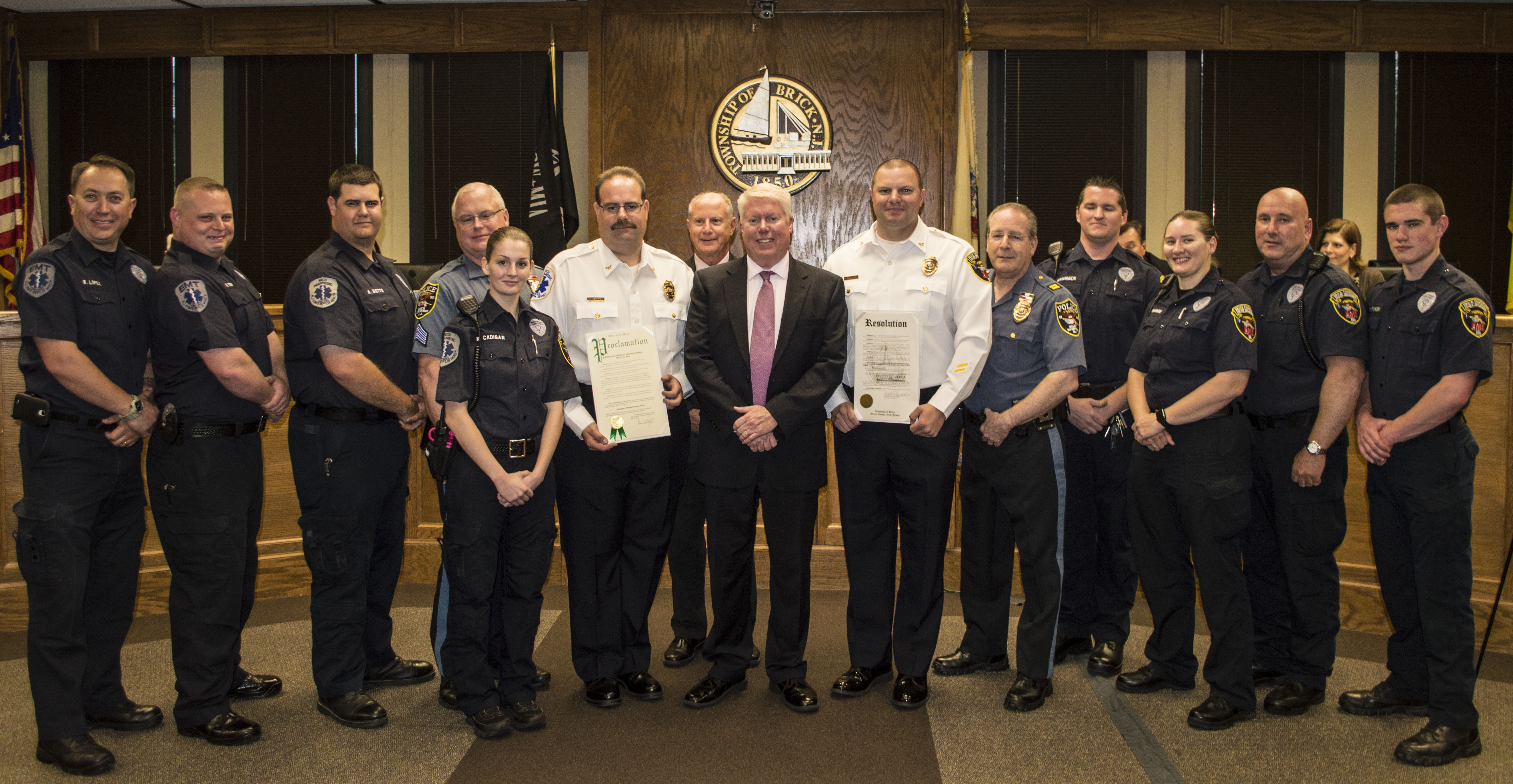 Brick Police EMS members are honored by Mayor John Ducey and township council members. (Photo: Daniel Nee)