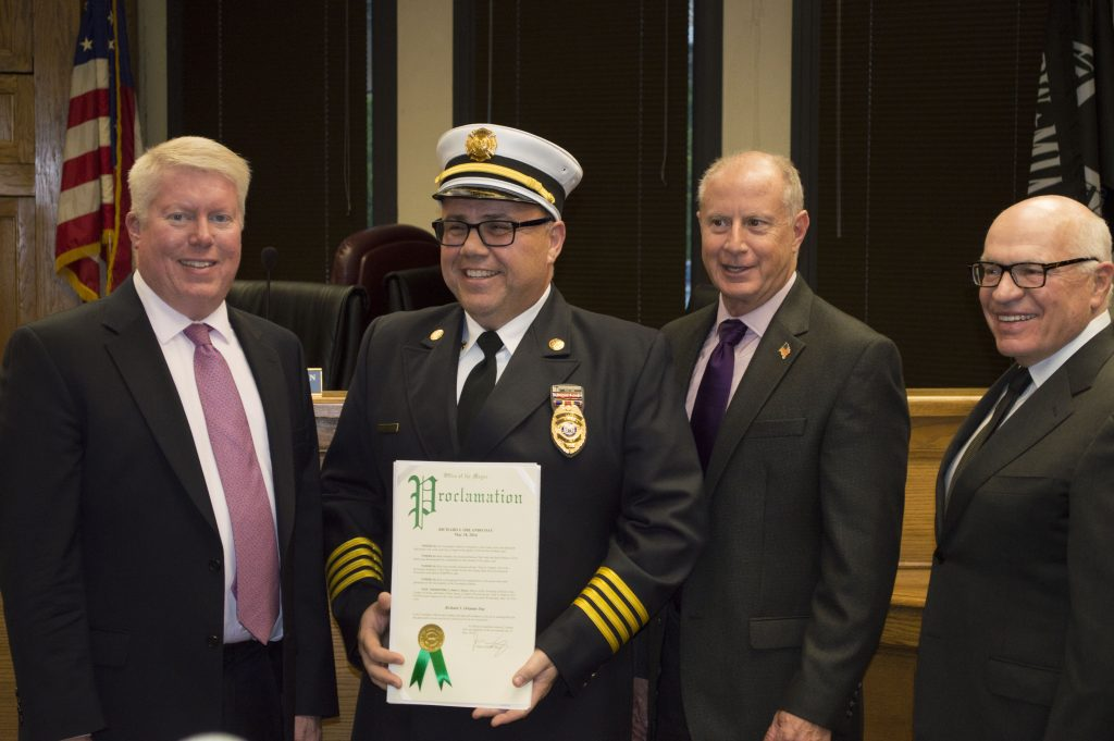 Rich Orlando is honored by Mayor John Ducey and township council members. (Photo: Daniel Nee)