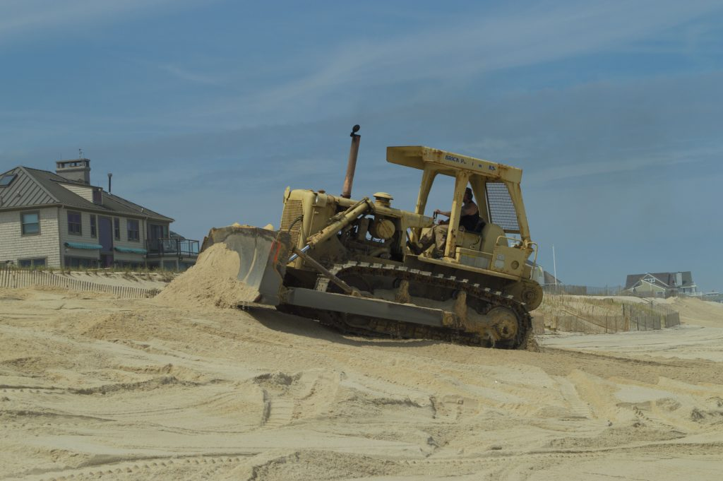 A bulldozer moves sand on Brick Beach III, May 11, 2016. (Photo: Daniel Nee)
