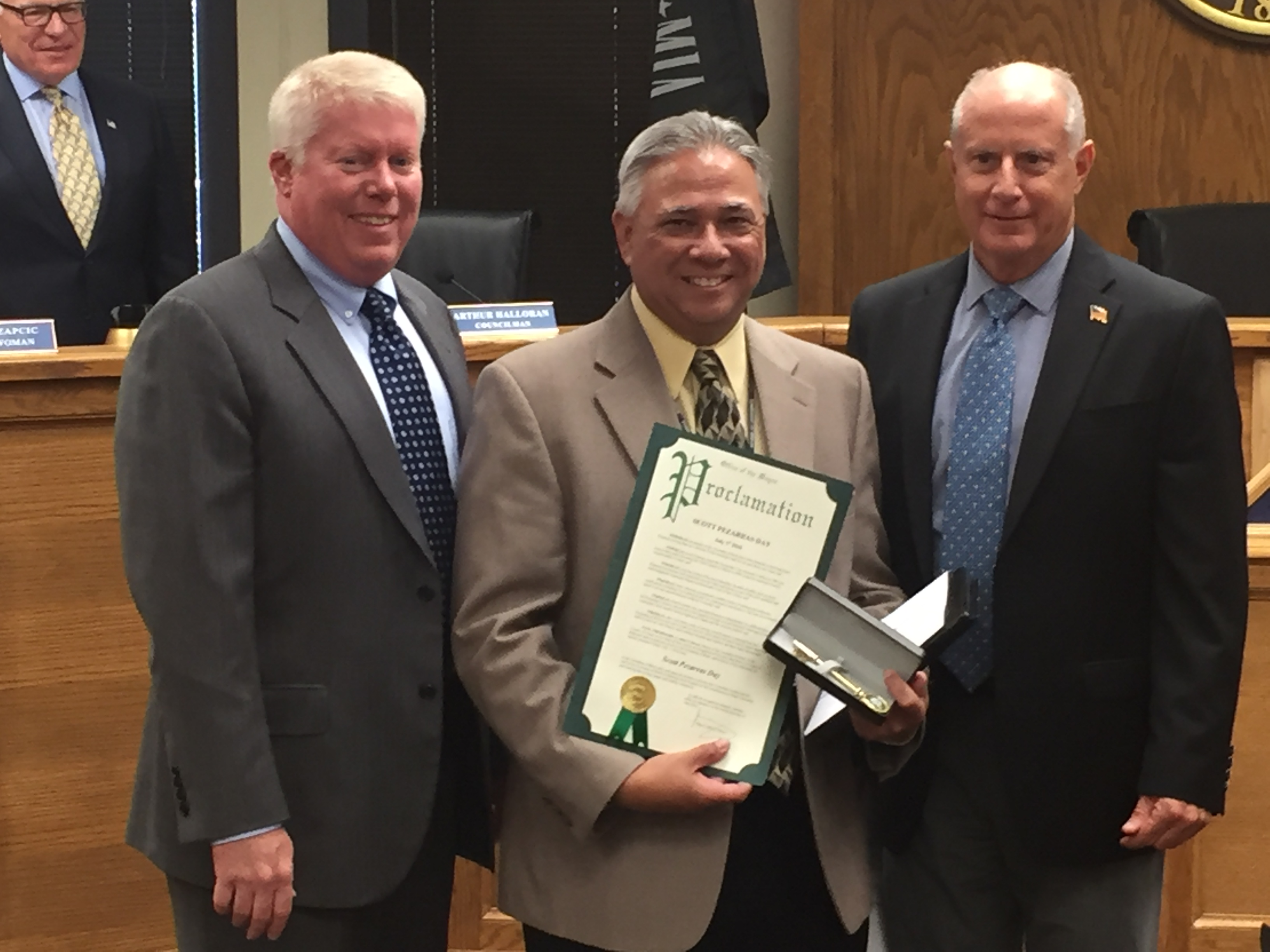 Scott Pezarras receives proclamations from Mayor John Ducey (left) and Council President Paul Mummolo (right). (Photo: Daniel Nee)