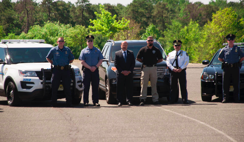 Prosecutor Joseph D. Coronato and Brick Police Chief Jim Riccio and other officers, announcing the start of an enforcement sweep of county road 528. (Photo: OCPO)