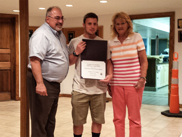 Zachary Crosio received a scholarship award from Grand Knight John Castle and Barbara Kearns. (Photo: Patricia Nee)