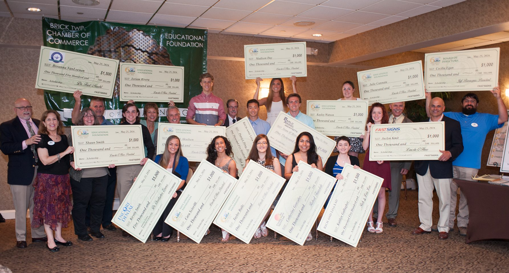 Oversized checks, donated by FASTSIGNS of Brick and representing $23,000 in awards to local scholars. (Photo: Brick Township Chamber of Commerce)