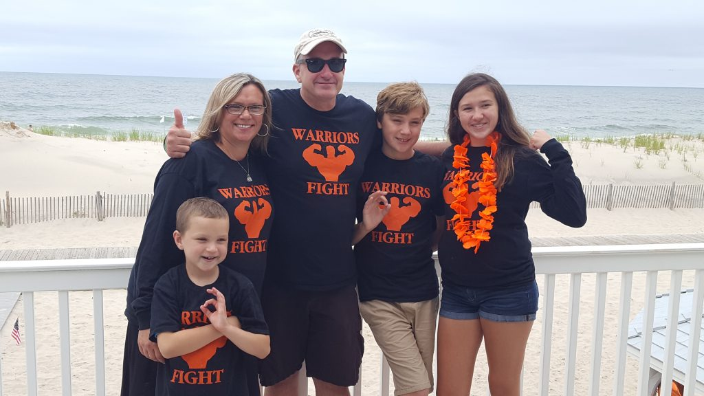 Family and friends of Matthew Dougard cheer on his flight over the ocean in Lavallette. (Photo: Kelly Dougard)