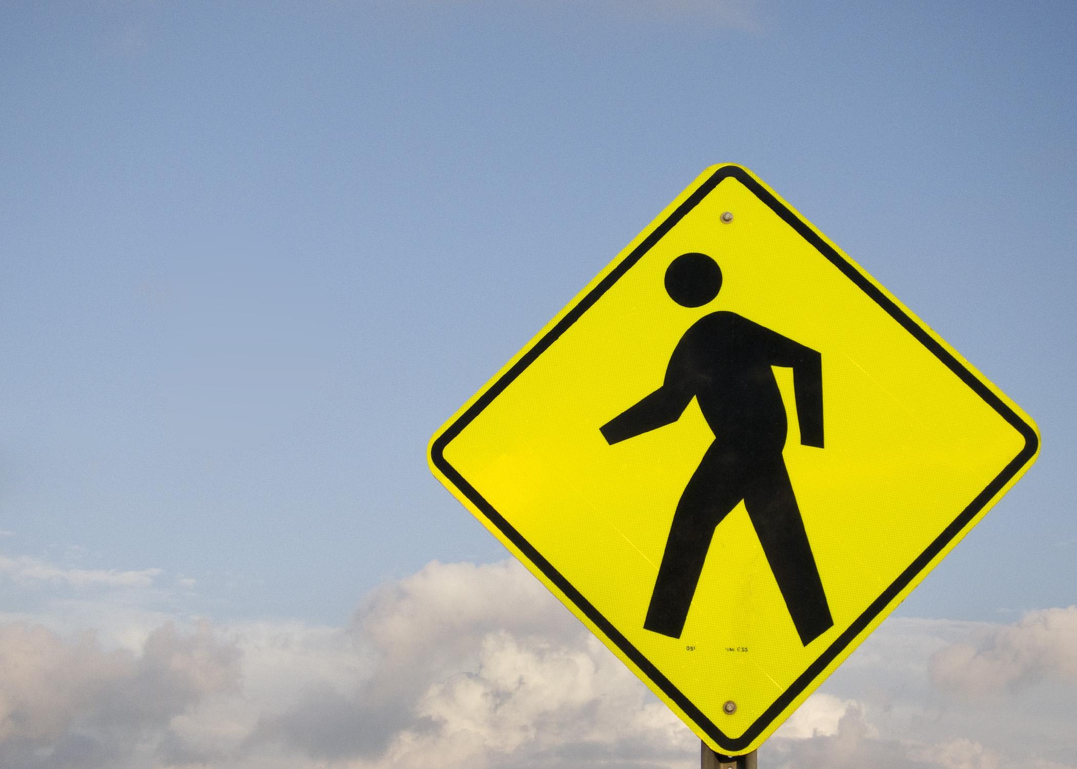Crosswalk sign. (Credit: Robert Couse-Baker/Flickr)