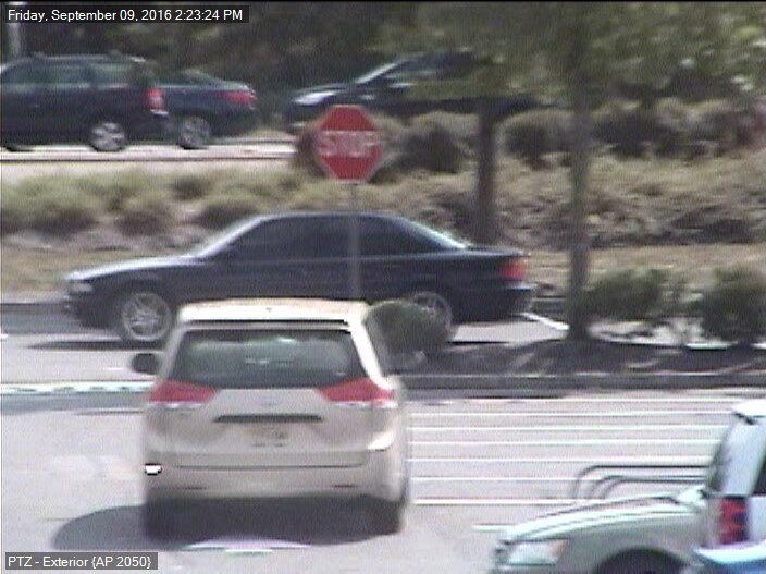 The suspect vehicle (car in the background) in an incident of illegal photography at a store dressing room. (Photo: Brick Twp. Police)