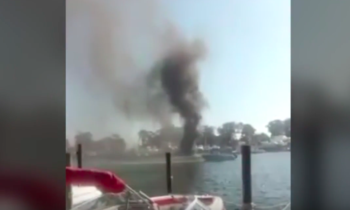 Firefighters remain on the scene of a boat fire at Comstock Marina in Brick. (Photo: Daniel Nee)