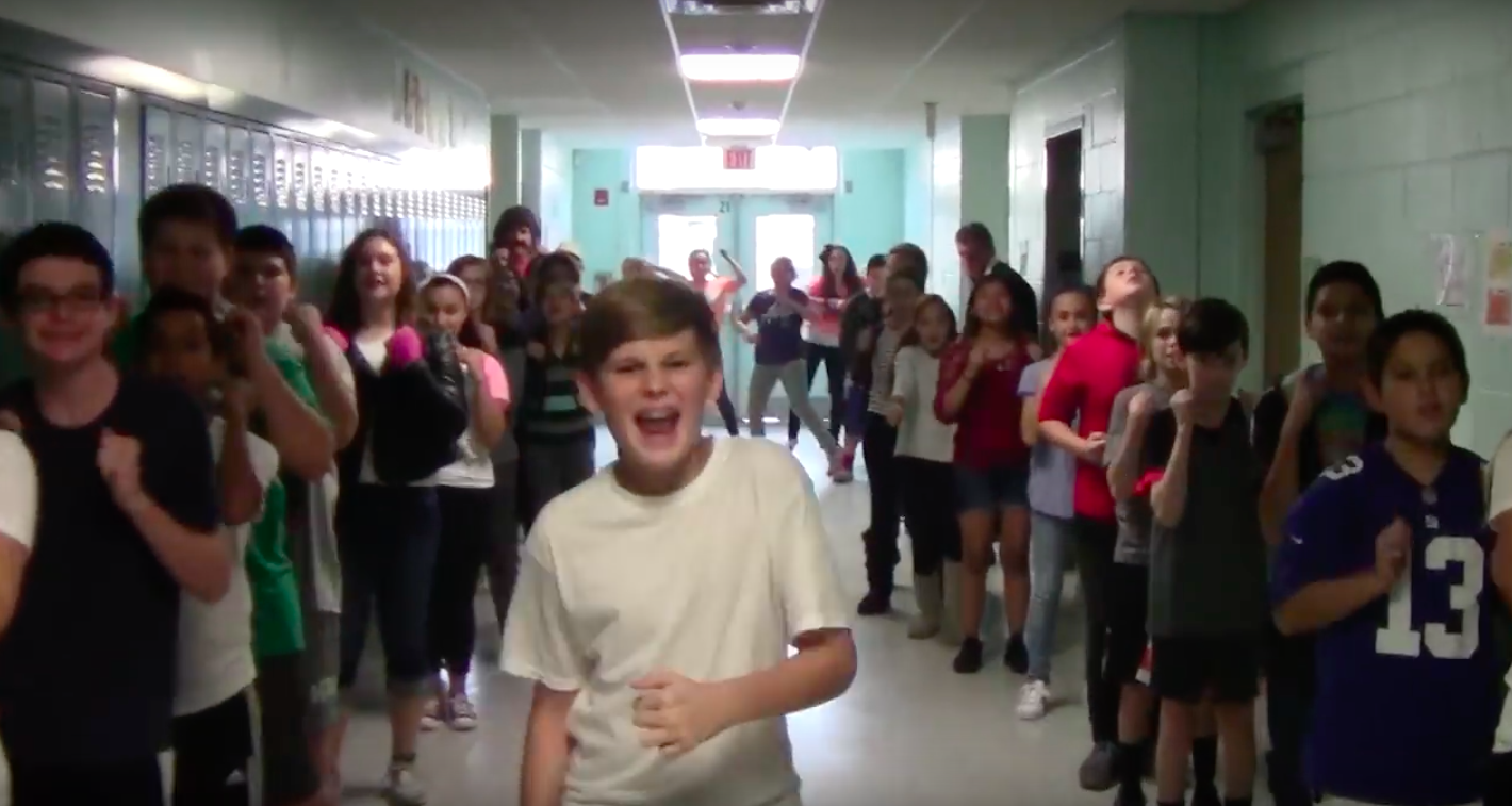 Lake Riviera Middle School students perform decades of music. (Screenshot: YouTube)