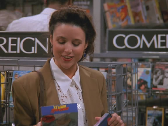 Elaine Benes, a Seinfeld character, browses for movies in a 1997 episode of the sitcom. (Credit: NBC)