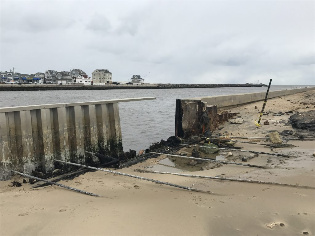 A hole in the bulkhead on the Point Pleasant side of Manasquan Inlet. (Photo: Daniel Nee)