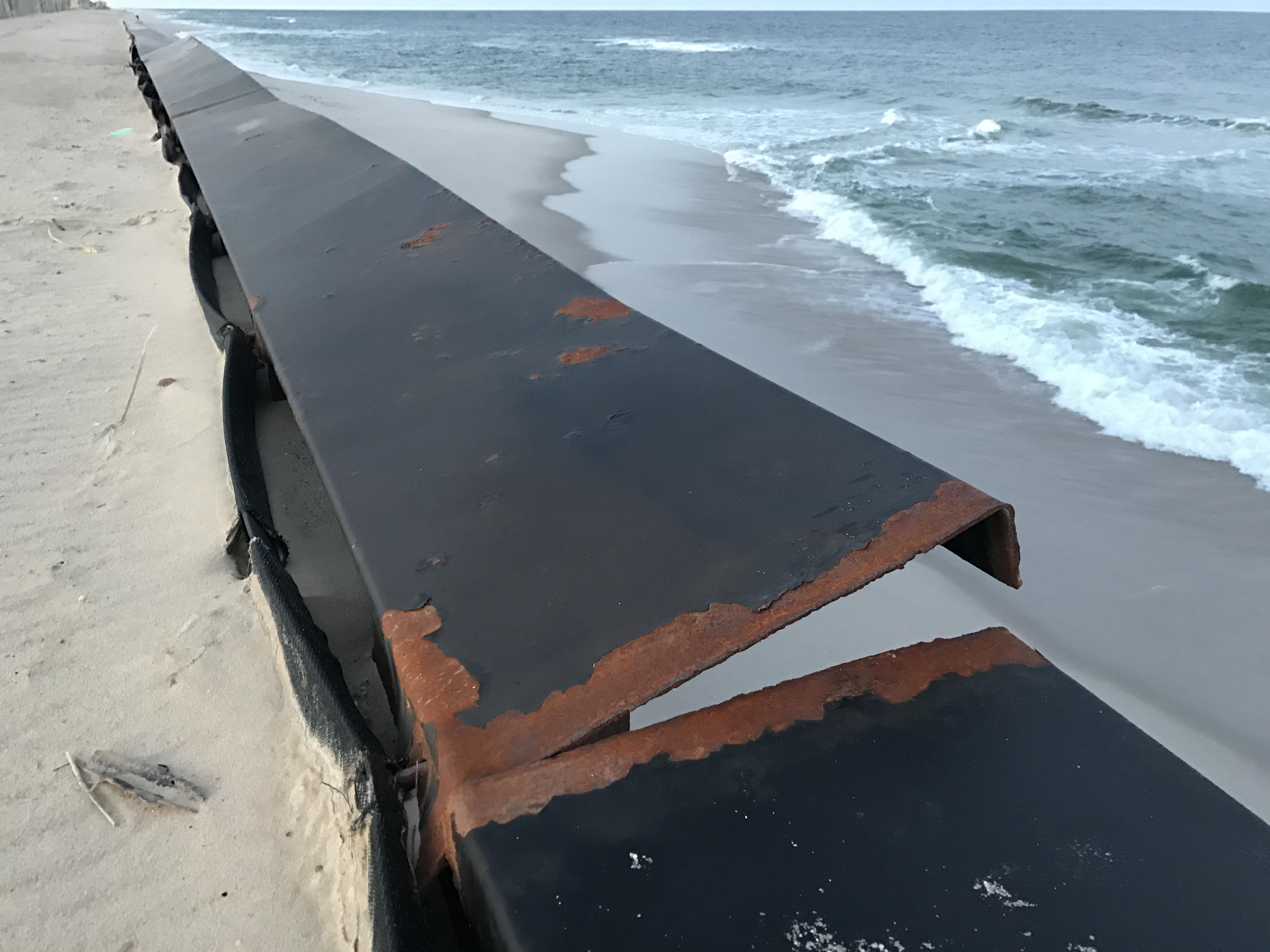 A bulkhead cap on Brick's sea wall is dislodged, March 2017. (Photo: Daniel Nee)