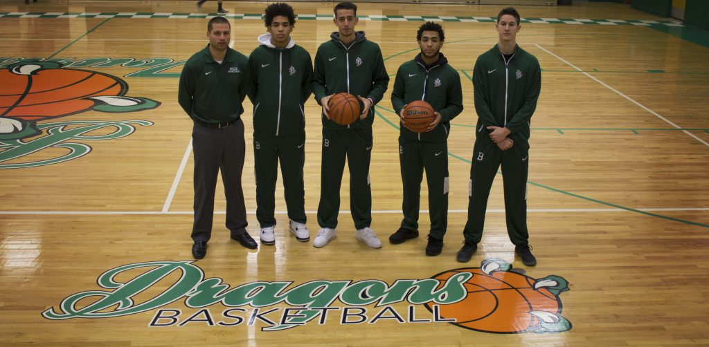 The Brick Township High School boys basketball team posted a winning record. From left to right are coach Mike Gawronski and four of the club's players--Shane Williams, Noah Buono, Brandon Williams and Anthony DeStefano. Photo credit: Luna Ortega