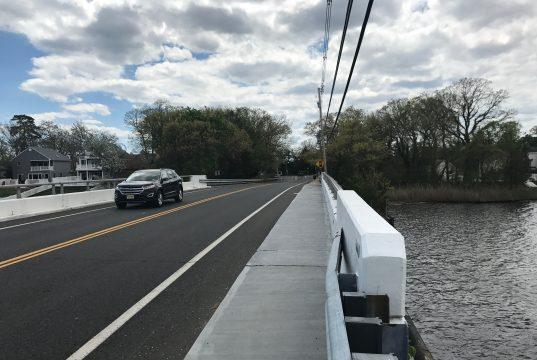 A vehicle traverses the Midstreams Bridge in Brick. (Photo: Daniel Nee)