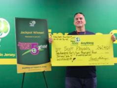 Scott Rhoads, of Brick, with his lottery winning check. (Photo: NJ Lottery)
