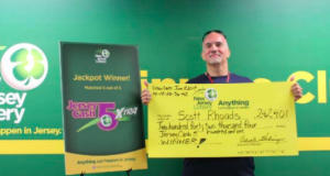 Scott Rhoads, of Brick, with his lottery winning check. (Photo: NJ Lottery)