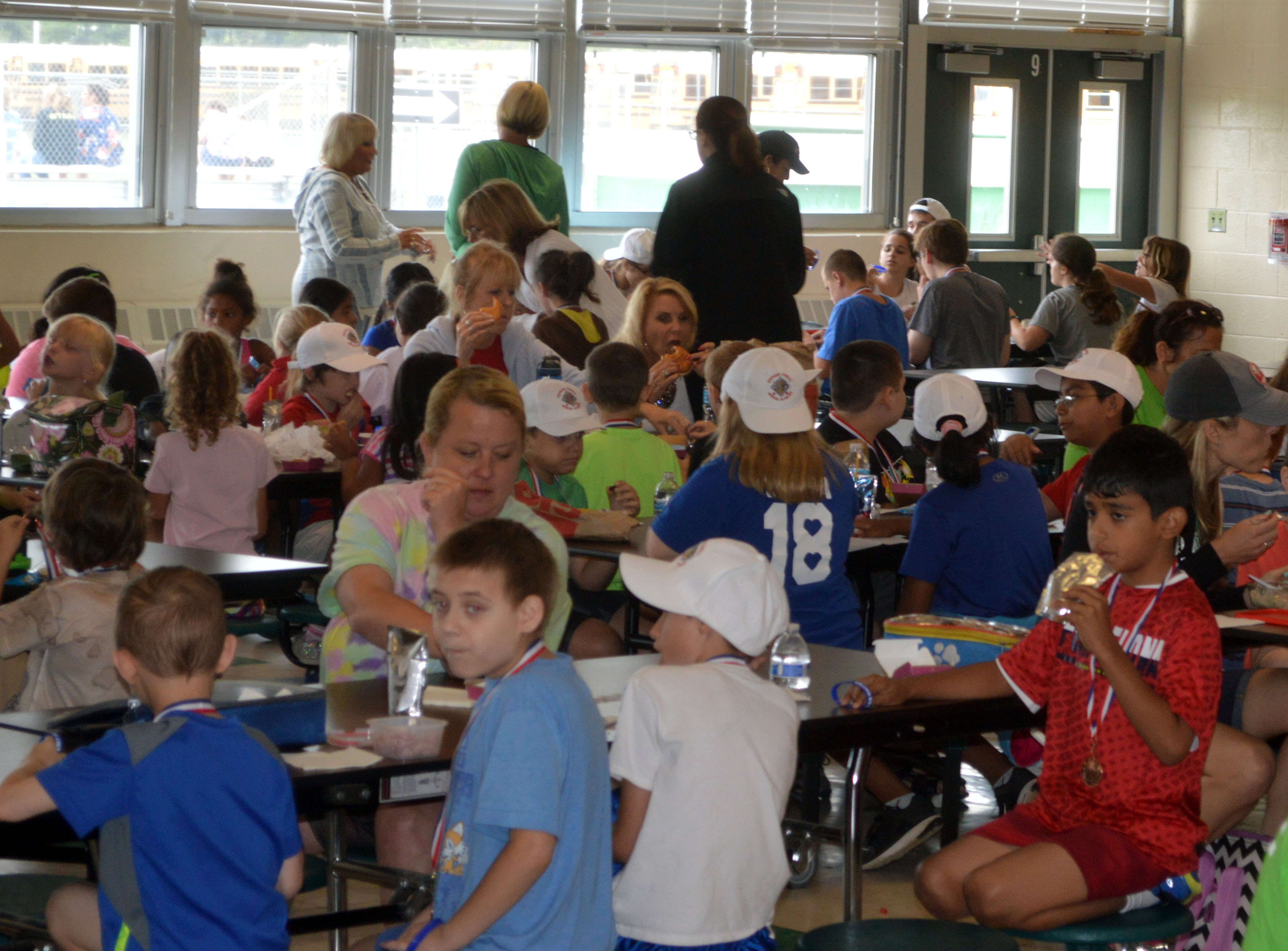 Students at Brick's BASE Camp program enjoying lunch provided by the Knights of Columbus Council 8160. (Photo: Daniel Nee)
